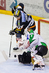 Harry Lange (Moser Medical Graz 99ers, #71) vs Jean-Philippe Lamoureux (HDD Tilia Olimpija, #1) during of ice-hockey match between Moser Medical Graz 99ers and HDD Tilia Olimpija in 11th Round of EBEL league, on October 14, 2011 at Eisstadion Graz-Liebenau, Graz, Austria. (Photo By Matic Klansek Velej / Sportida)