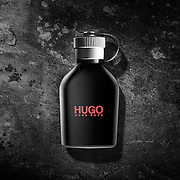 Hugo Boss aftershave mens cologne photographed on a rough textured black backgrounding Elinchrom studio lighting in the Hype photography studio.