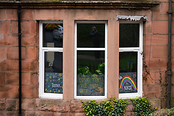 Glasgow, Scotland, UK. 3 April, 2020. Images from the south side of Glasgow at the end of the second week of Coronavirus lockdown. Pictured; hand drawn rainbows and messages in windows of flat in Shawlands. Iain Masterton/Alamy Live News