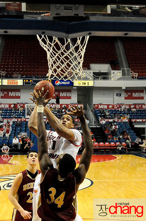 South Alabama's forward Augustine Rubit (21) shoots over Denver's forward, Chris Udofia (34), in the second half of play in Mobile, AL. Denver defeated South Alabama 67-50 on January 7, 2012.