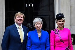 © Licensed to London News Pictures. 24/10/2018. LONDON, UK.  Theresa May, Prime Minister, greets King Willem-Alexander and Queen Maxima of the Netherlands at Number 10 Downing Street.  The King and Queen are in the UK on a state visit aimed at strengthening the bonds between the two nations.  Photo credit: Stephen Chung/LNP