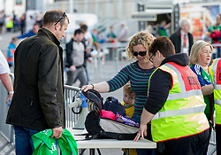 A lady has her backpack checked by a member of security before the international friendly match between Northern Ireland against New Zealand at Windsor Park, Belfast.