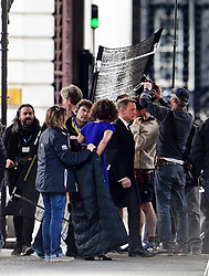 """© Licensed to London News Pictures. 30/05/2015. London, UK. Filming for the new James Bond film """"Spector"""" with Daniel Craig (centre) and Naomie Harris (blue dress) at the courtyard of the UK Government Treasury building in Westminster, London . Photo credit: Ben Cawthra/LNP"""