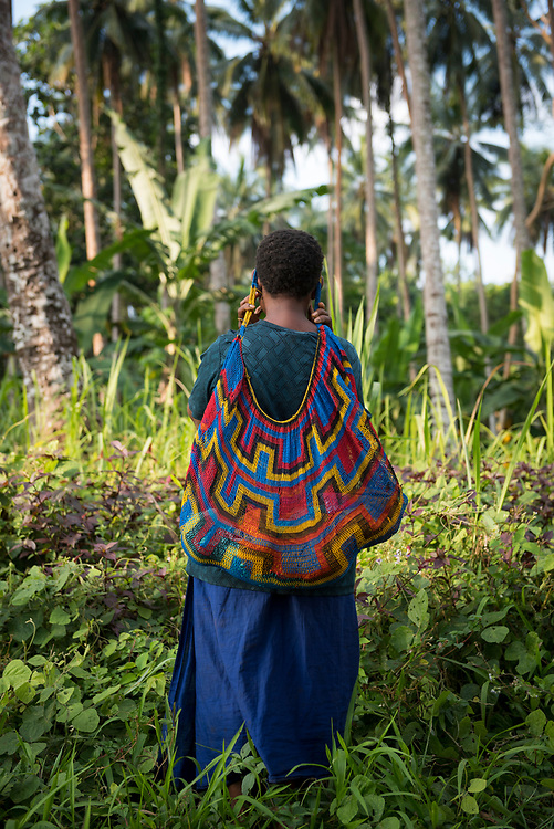 Kristin carries her six-month-old daughter Joy in a bilum near Kuduk village on Karkar Island in Madang Province, Papua new Guinea. The bilum is a traditional way to carry a young child in Papua New Guinea.