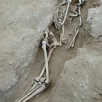 A Bronze-age skeleton lays in situ at an archaeological site above the Delger River near Muren, Mongolia.  These bones may be 2700+ years old.