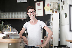 Mature woman standing in the coffee shop and smiling, Freiburg Im Breisgau, Baden-W¸rttemberg, Germany