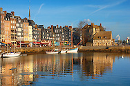 harbour buildings and yaughts. Honfleur, Normandy, France. . Honfleur is especially known for its old port, characterised by its houses with slate-covered frontages, painted many times by artists, including in particular Gustave Courbet, Eugène Boudin, Claude Monet and Johan Jongkind, forming the école de Honfleur (Honfleur school) which contributed to the appearance of the Impressionist movement. .<br /> <br /> Visit our FRANCE HISTORIC PLACES PHOTO COLLECTIONS for more photos to download or buy as wall art prints https://funkystock.photoshelter.com/gallery-collection/Pictures-Images-of-France-Photos-of-French-Historic-Landmark-Sites/C0000pDRcOaIqj8E