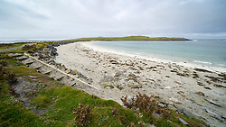 View of beach on Ayre or Tombolo at Banna Minn at Papil on West Burra, Shetland, Scotland Uk