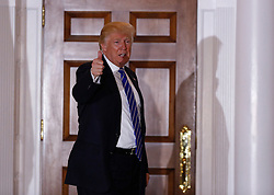 President-elect Donald Trump stands in front of the clubhouse of Trump International Golf Club, between meetings, November 19, 2016 in Bedminster Township, New Jersey. (Aude Guerrucci / Pool)