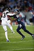 Tennessee Titans cornerback Malcolm Butler (21) bumps Jacksonville Jaguars rookie cornerback Quenton Meeks (43) on special teams kick coverage during the week 14 regular season NFL football game against the Jacksonville Jaguars on Thursday, Dec. 6, 2018 in Nashville, Tenn. The Titans won the game 30-9. (©Paul Anthony Spinelli)