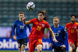 TALLINN, ESTONIA - Monday, October 11, 2021: Wales' Daniel James (L) and Estonia's Taijo Teniste during the FIFA World Cup Qatar 2022 Qualifying Group E match between Estonia and Wales at the A. Le Coq Arena. Wales won 1-0. (Pic by David Rawcliffe/Propaganda)