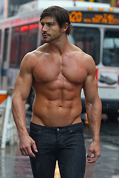 hot man without a shirt walking in New York City