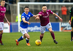 Queen of the South's Darren Lyon and Queen of the South's Dan Pybus. Arbroath 2 v 0 Queen of the South, Scottish Championship game played 15/2/2020 at Arbroath's home ground, Gayfield Park.