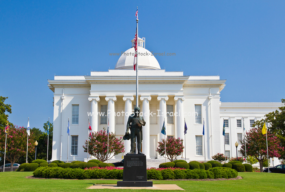 """The Alabama state capitol building Montgomery, AL, USA. Statue to fallen police officers, """"Duty Called"""" Memorial,"""