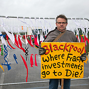 """Terry Robinson.<br /> """"I live roughly 5 miles away and I am here because my house shook in 2011 and I am against fracking in principal full stop. Its possible they are taking fracking equipment out to bring in the drilling rig. Its all just theories at the moment. I believe the license to drill four wells is three years so they still got two wells to do.""""<br /> It is Green Monday and first week of the second anniversary of Cuadrilla's fracking exploration in Preston New Road. For two years activists have been keeping an eye on the fracking company Cuadrilla from the roadside of the fracking site in Preston New Road. The company has not actively fracked since November and is currently seemingly busy emptiyng the site for heavy equipment. Prostesters and climate protectors are still by the gates trying to work out Cuadrilla's intensions."""