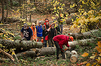 A crew of volunteers set out to clear the trails at Ramblin' Vewe Farm in Gilford on Sunday morning following the devastation resulting from last Sunday's storm.  (Karen Bobotas/for the Laconia Daily Sun)