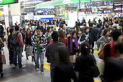 daily commuters Shinjuku railway station Japan