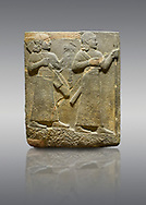 Picture & image of Hittite relief sculpted orthostat stone panel of Royal Buttress. Basalt, Karkamıs, (Kargamıs), Carchemish (Karkemish), 900-700 B C. Warriors. Anatolian Civilisations Museum, Ankara, Turkey.<br /> <br /> Two figures are seen, each with a long dress, a thick belt and curled hair. The figure in front carries a spear in his left hand and a long sword at his waist, and the figure behind carries an axe in his left hand and a quiver on his back.   <br /> <br /> Against a gray background. .<br />  <br /> If you prefer to buy from our ALAMY STOCK LIBRARY page at https://www.alamy.com/portfolio/paul-williams-funkystock/hittite-art-antiquities.html  - Type  Karkamıs in LOWER SEARCH WITHIN GALLERY box. Refine search by adding background colour, place, museum etc.<br /> <br /> Visit our HITTITE PHOTO COLLECTIONS for more photos to download or buy as wall art prints https://funkystock.photoshelter.com/gallery-collection/The-Hittites-Art-Artefacts-Antiquities-Historic-Sites-Pictures-Images-of/C0000NUBSMhSc3Oo