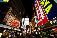 Dotonbori is famous for its shops and restaurants displaying neon and mechanized signs, notably moving giant crabs and candy manufacturer Glico giant electronic display of a runner crossing the finish line -  and other dramatic kitsch.