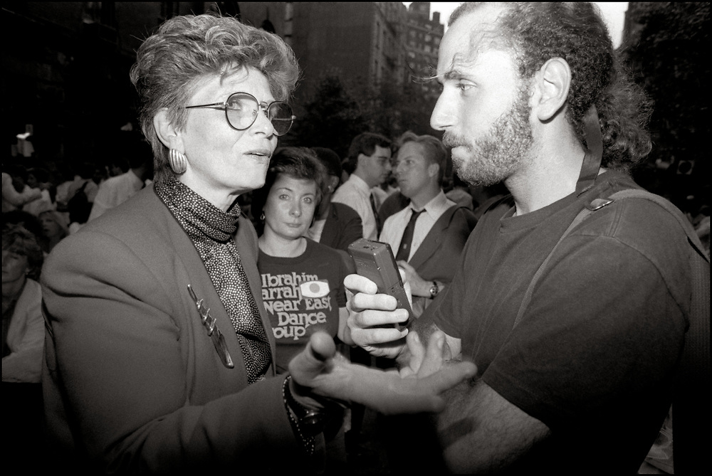 """Virginia Apuzzo and Andrew Miller at The Gay and Lesbian Community Center's garden party in New York, NY in June of 1989.<br /> <br /> Andrew Miller was a founder and the news editor of Outweek magazine and has taught writing and journalism at Polytechnic Institute of New York University. He has also been a book editor at John Wiley & Sons, HarperCollins, Hearst, and Random House. His byline appears frequently in the LGBT press, especially New York's Gay City News, and he has contributed to and ghostwritten several books, including Youth In Crisis: What Everyone Should Know About Growing Up Gay. He is a member of Queer Nation, a direct action group dedicated to ending discrimination, violence and repression against the LGBT community. Miller lives in New York City.<br /> <br /> Virginia """"Ginny"""" Apuzzo (born June 26, 1941) is an American gay rights and AIDS activist. She is a former executive director of the National LGBTQ Task Force. She served as executive deputy of the New York State Consumer Protection Board and as the vice chair of the New York State AIDS Advisory Council. She was also President of the New York State Civil Service Commission and Commissioner of the New York State Department of Civil Service. In 1996, she became the Associate Deputy Secretary of Labor at the United States Department of Labor, and in 1997 she became the Assistant to the President for Management and Administration under the Clinton administration. In 2007, she began serving on the Commission on Public Integrity, where she worked until her retirement. - From Wikipedia"""