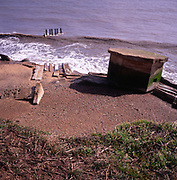 A294R0 Second world war pillbox eroded by the sea Bawdsey Suffolk England