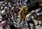 France, Bedoin, 25 July 2009: Alberto Contador Velasco (Spa) Astana in the race leader's Maillot Jaune, looks across to Andy Schleck on the climb of Mont Ventoux  during Stage 20 - Montélimar to Mont Ventoux (167 km). Photo by Peter Horrell / http://peterhorrell.com .