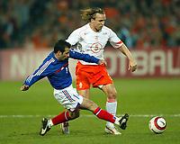 Photo: Scott Heavey.<br /> Holland v France. Feyenoord Stadium. 31/03/2004.<br /> Ludovic Giuly (L) of France slides in on Bolo Zenden