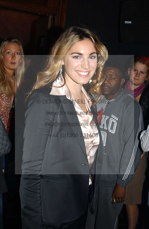 KELLY BROOK at a party to celebrate a new collection of sexy underware by Janet Reger called 'Naughty Janet' held at 5 Cavendish Square, London on 19th October 2004.<br /><br />MINIMUM REPRODUCTION FEE - SEE OUR WEB SITE<br /><br />NON EXCLUSIVE - WORLD RIGHTS-