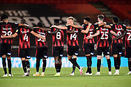 Bournemouth players put their arms over each others shoulders during the penalty shootout during the EFL Cup match between Bournemouth and Crystal Palace at the Vitality Stadium, Bournemouth, England on 15 September 2020.