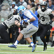 Colto Huntsman, (right), Air Force, is tackled by Rhyan England, Army, during the Army Black Knights Vs Air Force Falcons, College Football match at Michie Stadium, West Point. New York. Air Force won the game 23-6. West Point, New York, USA. 1st November 2014. Photo Tim Clayton