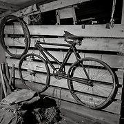 Bicycle in stable, I'd like to hear more about how this bicycle was used and how far they rode it.