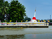 02 AUGUST 2018 - PAK KRET, NONTHABURI, THAILAND: The angled stupa at Wat Poramaiyikawat on Ko Kret. Ko Kret (also spelled Koh Kret) is a small island in the Chao Phraya River in Nonthaburi province north of Bangkok. It is about 2 km long and 1 km wide. It has seven main villages, the largest and most populous being Ban Mon. Ko Kret was created in 1722 when a canal was dug in the Chao Phraya River to bypass a bend. Most of the people on the island are ethnically Mon, from the hills of western Thailand and eastern Myanmar (Burma). The island is popular as a weekend daytrip from Bangkok. The island is famous for the Mon style pottery made on the island.      PHOTO BY JACK KURTZ