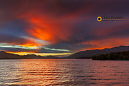 Breaking storm clouds at sunset over Whitefish Lake in Whitefish, Montana, USA