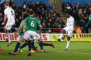 Wilfried Bony of Swansea city  ® shoots and scores his teams 1st goal to make it 1-0. . Premier league match, Swansea city v West Bromwich Albion at the Liberty Stadium in Swansea, South Wales on Saturday 9th December 2017.<br /> pic by  Andrew Orchard, Andrew Orchard sports photography.