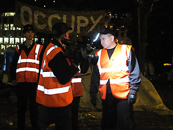 © licensed to London News Pictures. London, UK. 14/07/12. Bailiffs carrying video recording equiptment survery the site. Enforcement officers clear the remaining 'Occupy' protest camp in London's Finsbury Square during the early hours of this morning after Islington Council won a High Court battle over the site. Photo credit: Jules Mattsson/LNP