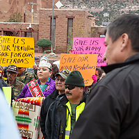Miss Navajo Nation Autumn J. Montoya, listens speaker LoRenzo C. Bates, with the veterans at the steps of the Navajo Nation Council Chambers, in Window Rock on Wednesday.