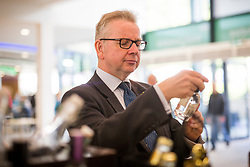 © Licensed to London News Pictures. 12/07/2017. Harrogate UK. Michael Gove Secretary of State for Environment, Food & Rural Affairs buys a bottle of Masons Gin at the 159th Great Yorkshire Show in Harrogate today. Photo credit: Andrew McCaren/LNP