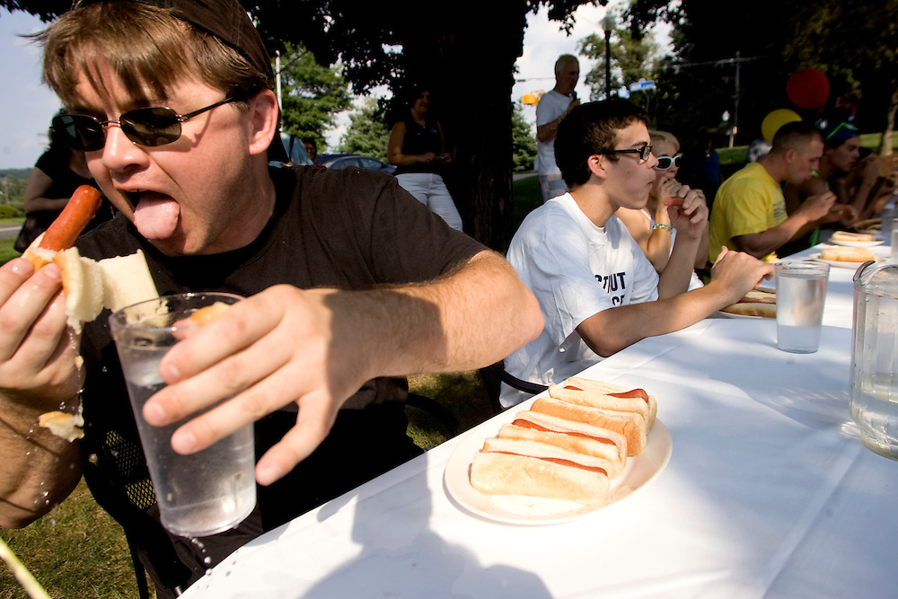 Southbury, Conn. - Aug. 16, 2009 Fred Colgan, of Southbury, tries to catch his first hot dog before it breaks apart during Sunday's hot dog eating contest at Leo's Restaurant in Southbury to benefit the Special Olympics of Connecticut. Colgan came in second in his heat, after eating 13 hot dogs in seven minutes. .Josalee Thrift Photo