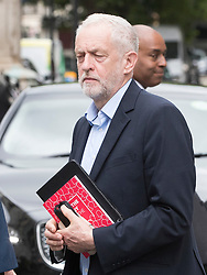 © Licensed to London News Pictures. 30/05/2017. London, UK. Labour Party Leader Jeremy Corbyn leaves BBC Broadcasting House carrying his iPad and a copy of the manifesti after appearing on Radio Four's Woman's Hour programme.  Photo credit: Peter Macdiarmid/LNP