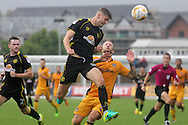 Crewe Alexandra's Jon Guthrie heads the ball away from Newport' county's  Sean Rigg. Skybet EFL league two match, Newport county v Crewe Alexandra at Rodney Parade in Newport, South Wales on Saturday 20th August 2016.<br /> pic by David Richards, Andrew Orchard sports photography.