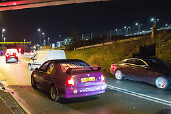"© Licensed to London News Pictures . 30/11/2015 . Leeds , UK . Traffic swerves around a broken down car dressed in UKIP livery outside Elland Road stadium ahead of Nigel Farage's address to a "" Say No to the EU "" event at the Leeds United's ground . The driver reported that the clutch had failed . Photo credit: Joel Goodman/LNP"