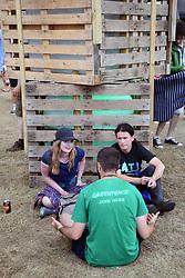 Latitude Festival, Henham Park, Suffolk, UK July 2019. Greenpeace volunteer