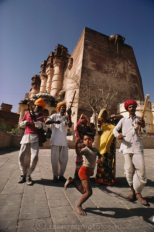 A family of musicians performing for tips in Jodhpur, Rajasthan, India.