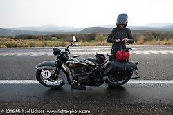 Sharon Jacobs suits up for the rain beside her 1936 Harley-Davidson VLH during Stage 13 (257 miles) of the Motorcycle Cannonball Cross-Country Endurance Run, which on this day ran from Elko, NV to Meridian, Idaho, USA. Thursday, September 18, 2014.  Photography ©2014 Michael Lichter.
