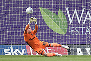 AFC Wimbledon goalkeeper `Aaron Ramsdale (35) makes an important save during the EFL Sky Bet League 1 match between Oxford United and AFC Wimbledon at the Kassam Stadium, Oxford, England on 13 April 2019.