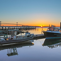 Rhode Island sunrise photographs of the Jamestown Newport ferry at Conanicut Marina in Jamestown, Rhode Island with the Claiborne Pell Bridge in the background are available for image licensing and as museum quality photography prints, canvas prints, acrylic prints, wood prints or metal prints. Wall art prints may be framed and matted to the individual liking and room decor needs:<br /> <br /> http://juergen-roth.pixels.com/featured/jamestown-newport-ferry-at-conanicut-marina-juergen-roth.html<br /> <br /> Coastal Rhode Island seascape sunrise photography showing the Jamestown Newport ferry at Conanicut Marina in Jamestown in the foreground while the background features the Newport Bridge that spans Narragansett Bay connecting the City of Newport on Aquidneck Island and the Town of Jamestown on Conanicut Island. Rhode Island has become an inspiration and is a heaven for macro, seascape, and landscape photography that makes for great wall art. Especially sunrise, sunset and the light of the golden hours paint the sky in beautiful colors and bring out the beauty of the Ocean State.<br /> <br /> Good light and happy photo making! <br /> <br /> My best, <br /> <br /> Juergen <br /> Image Licensing: http://www.RothGalleries.com <br /> Fine Art Prints: http://fineartamerica.com/profiles/juergen-roth.html <br /> Photo Blog: http://whereintheworldisjuergen.blogspot.com <br /> Twitter: https://twitter.com/naturefineart <br /> Facebook: https://www.facebook.com/naturefineart <br /> Instagram: https://www.instagram.com/rothgalleries
