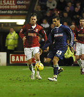 Photo: Dave Linney.<br />Walsall v Swindon Town. Coca Cola League 2. 09/12/2006.<br />Walsall's Daniel Fox(L) closes in on  Curtis Weston.