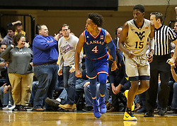 Jan 15, 2018; Morgantown, WV, USA; Kansas Jayhawks guard Devonte' Graham (4) celebrates after making a three pointer during the second half against the West Virginia Mountaineers at WVU Coliseum. Mandatory Credit: Ben Queen-USA TODAY Sports
