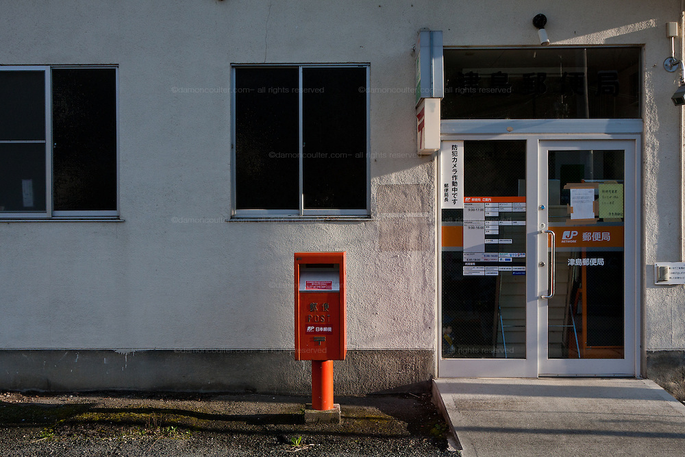 The post office in the abandoned village of Tsushima in Fukushima, Japan. Friday May 4th 2012. After the explosions at the Daichi nuclear plant caused by the March 11th 2011 earthquake and tsunami, High levels of radioactive contamination in this village have made it uninhabitable.