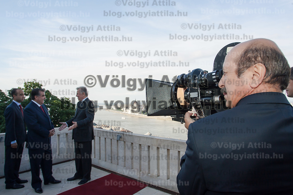 Member of the Tajik press prepares to record with his analogue film camera President of Tajikistan Emomali Rahmon (L) and his Hungarian counterpart Pal Schmitt (2nd L) have a sight-viewing in Budapest, Hungary on June 10, 2011. ATTILA VOLGYI.Emomali Rahmon is in Hungary fro a two-day official visit.